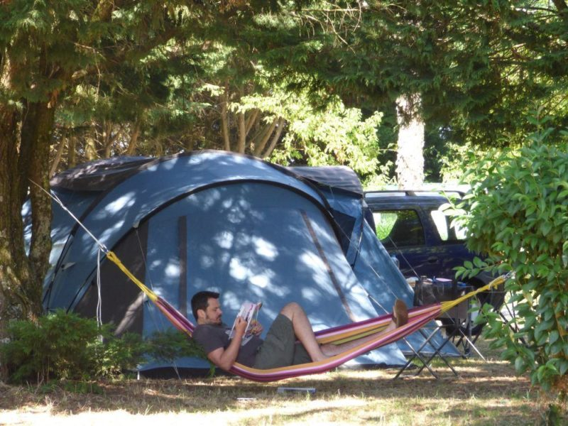 A camper in a hammock on his site near Brousse and Villaret